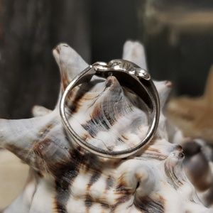 Sterling silver dolphin ring with diamond eyes